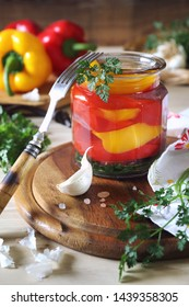 Pickled salad bell pepper in jar and ingredients. Rustic style