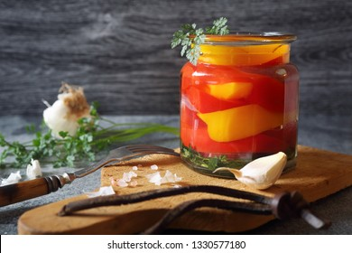 Pickled salad sweet bell red and yellow pepper on dark background