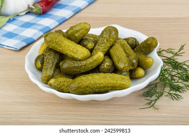 Pickled small cucumber with dill and spices