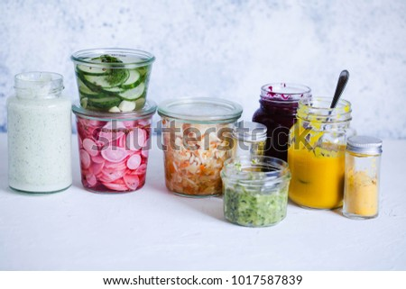 Pickled vegetables smoothie topping dressing sauce in a jar Foods in a jar Vegan healthy keto dieting food concept