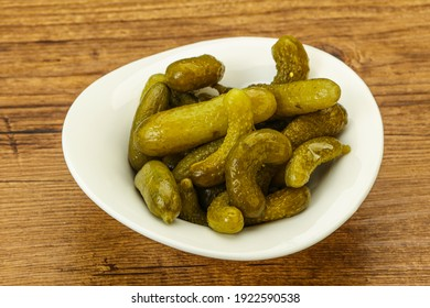 Pickled young gherkin in the bowl