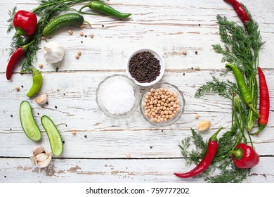 pickles background on white wooden table with green and red and chilli peppers,fennel,salt,black peppercorns,garlic,pea,close up,healthy concept,top view,flat lay