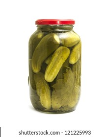 pickles in a glass jar is isolated on a white background