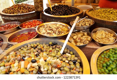 Pickles varied olives onion carrot lupins hot pepper gherkin in a row. Italy. Sicily