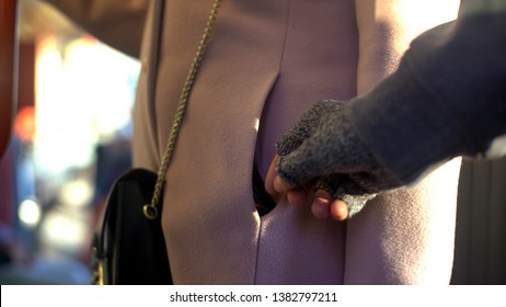 Pickpocket thief stealing purse from lady commuter, public transport crime rate