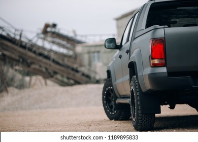 Pickup car at the gravel carrier. Suv car view from the back