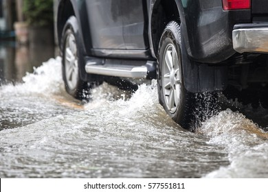 Pickup truck on a flooded street