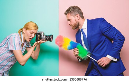 Picky and curious. Girl photographer capture every tiny dust. Focused on dust. Attentive reporter capture dirty reportage. Too much attention detail. Shooting through clean camera lens. Wipe dust.