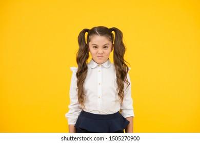 Picky kid. Adorable schoolgirl. Schoolgirl pupil long hair cute ponytails hairstyle. Educational program. Homeschooling visiting regular school. Efficiency studying. Emotional expression schoolgirl.