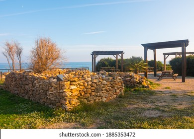 Picnic area near the sea in the Serra d'Irta Natural Park, Alcossebre, Spain. Wooden structure. Beautiful spot to relax and have a snack.