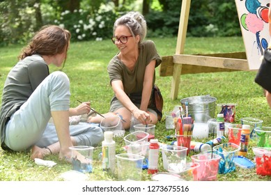 Picnic with arts elements. One time in the year a this place comes artists and arts lovers with their families.  Girls artists paint a picture. Rezekne - Latvia, July 24, 2018