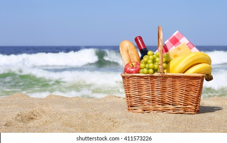 Picnic basket with food on the beach