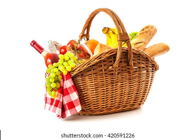picnic basket with fruit, bread and wine isolated on white