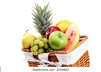 picnic basket full of delicious fruits isolated on white