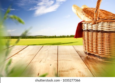 Picnic basket on table and spring landscape.