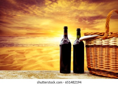 picnic basket and summer sunset time