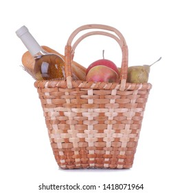 Picnic basket with wine fruit and other products on a white isolated background. Summer rest . Camping. Picnic in nature.
