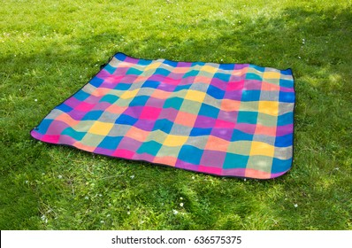 Picnic blanket outdoors on grass