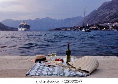 Picnic for a couple on a pierce in a harbor in Kotor, Montenegro