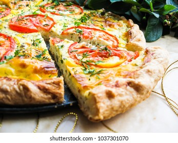 Picnic food. Homemade puff pastry pizza pie with cream cheese and dill filling, mozzarella cheese, tomatoes, fresh parsley, selective focus. For breakfast and lunch.
