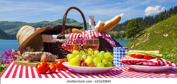 Picnic in french alpine mountains with lake on background