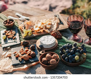picnic in nature with fresh fruit and wine