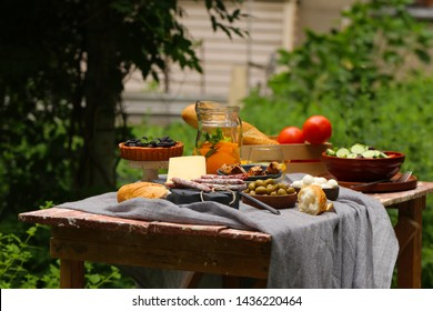 picnic in nature, pies and salads, fresh berries and fruits