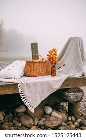 picnic on a foggy morning by the lake. Autumn concept