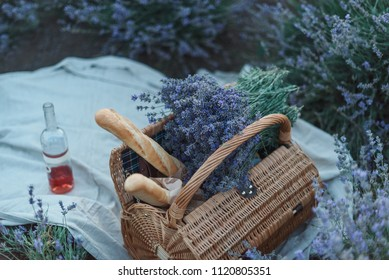 picnic on a sunset lavender field, picnic basket, French baguettes, wine
