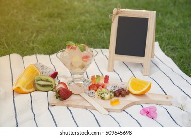 Picnic in the park berry fruit jelly with fresh fruits and board - summer dessert