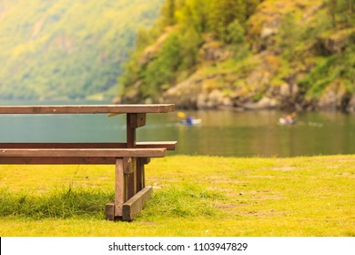 Picnic site wooden table and benches in norwegian nature, Europe.