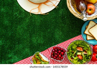 picnic in summer with products, fruits, drinks and hat on white background top view space for text