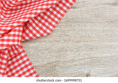 Picnic table cloth. Seamless checkered pattern. Vintage red plaid fabric texture.
