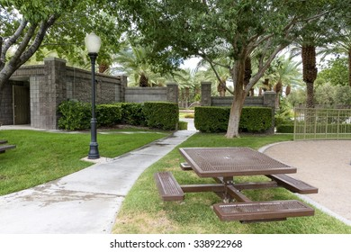 Picnic Table Next To Sidewalk In An Upscale Residential Neighborhood