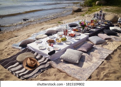 Picnic table on the beach near the lake