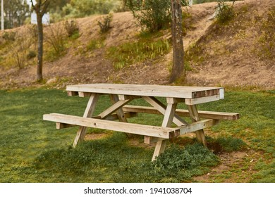 Picnic table in a park with green area