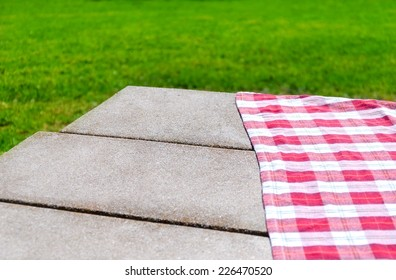 Picnic tablecloth textile on the table background
