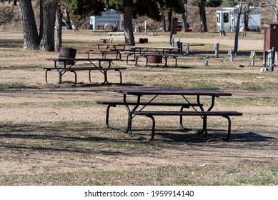 Picnic tables in empty camping spots