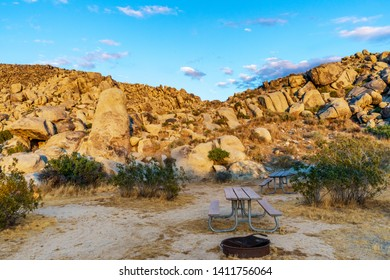 Picnic tables and fire ring at Horsemen's Center Park in Apple Valley, California in the Mojave Desert