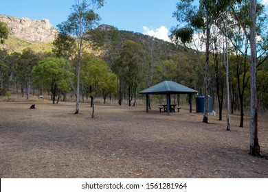 Picnic tables at the start of the walking track to the summit of Mount Walsh in Queensland, Australia.