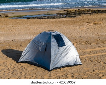 Picnic tents along the coast.