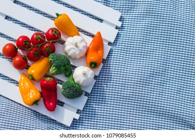 Picnic time. Vegetables and tulips on the a picnic blanket. Healthy lifestyle concept
