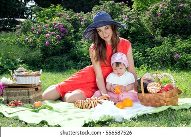 Picnic, a young mother with a child on the nature