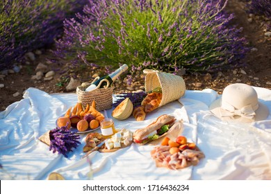 picnik in lavender field with honet melone wone and cheese background