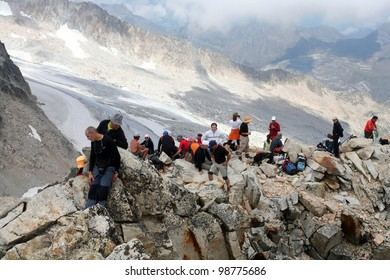 PICO DE ANETO, SPAIN - AUGUST 18: 50 meters before the top. Climbers resting before the last leg, August 18, 2009 in Huesca, Spain. Pico de Aneto is the highest mountain in Pyrenees at 3404 meters.