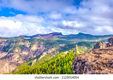 Pico de las Nieves peak over rocky landscape and pine forest, Gran Canaria, Spain