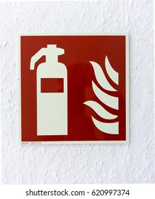 Pictogram for hand-held extinguisher on a white wall