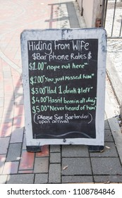 Picton,Marlborough/New Zealand-December 13,2016: Mikeys Bar humorous chalkboard sign on sidewalk in Picton, New Zealand
