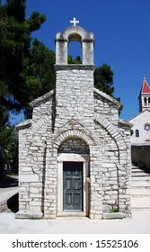 Pictoresque, old St Ivan & Teodor chapel within Dominican monastery in tourist place Bol on island of Brac, Croatia.