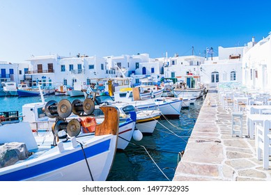 Pictoresque whitewashed port of Naoussa, Paros island, Cyclades Archipelago, Greece.